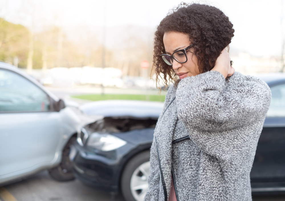 Woman suffering from whiplash after an auto accident